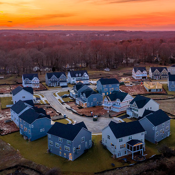 Curving suburban neighborhood dead end street with newly constructed single family homes in an American residential real estate | Spyglass Lending
