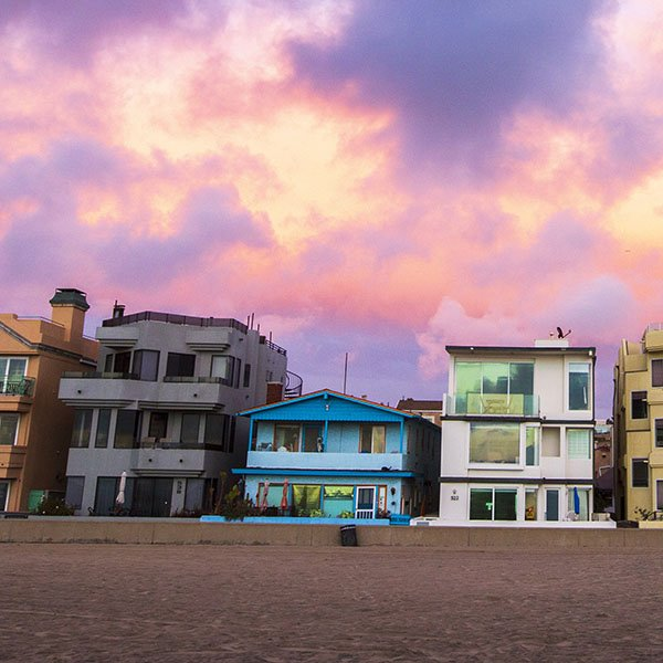Dramatic-storm-clouds-hover-over-the-colorful-beach-cityscape-of-Hermosa-Beach-California-just-after-sunset.-sq